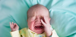 baby crying due to pain
