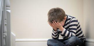 CHILD CRYING IN CORNER