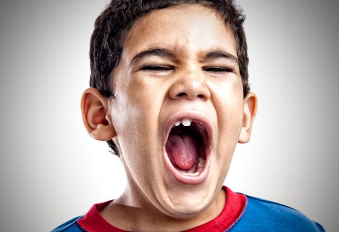 A little boy screaming with anger