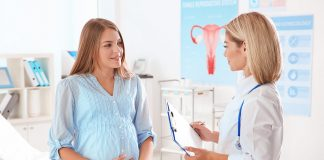 A pregnant woman talking to her gynaecologist