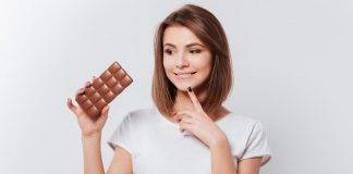 A woman thinking about eating chocolate