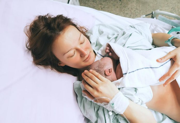 A mother holding her newborn just after childbirth