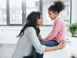 A mother talking to her daughter.