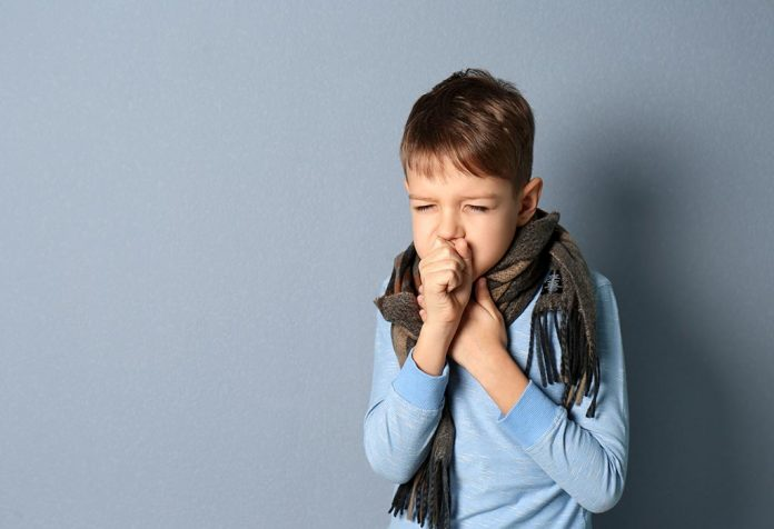 A little boy coughing