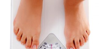 A woman measuring her weight