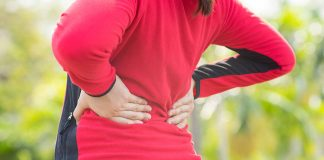 A woman suffering from back pain