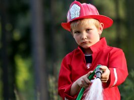 A little boy with a water hose